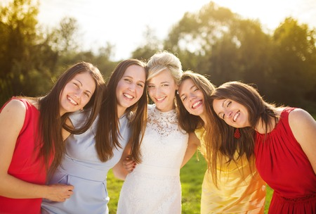 wedding portrait: Outdoor portrait of beautiful young bride with her female friends