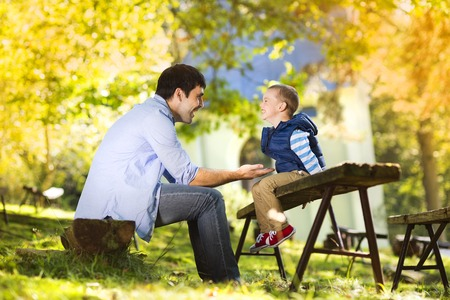 Father and son spending time together in summer nature photo
