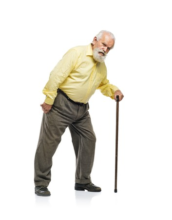 1 mature man: Old bearded man walking with cane isolated on white background