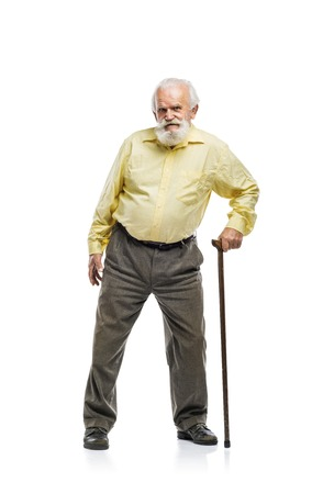 70s adult: Old bearded man walking with cane isolated on white background