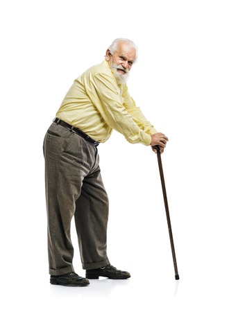 guy with walking stick: Old bearded man with cane suffering from back pain isolated on white background Stock Photo