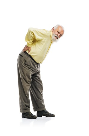 Old bearded man suffering from back pain isolated on white background photo