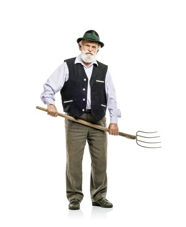 Old bearded bavarian man in hat holding pitchfork in his hand, isolated on white background photo