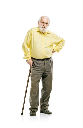 Old active bearded man walking with cane isolated on white background photo