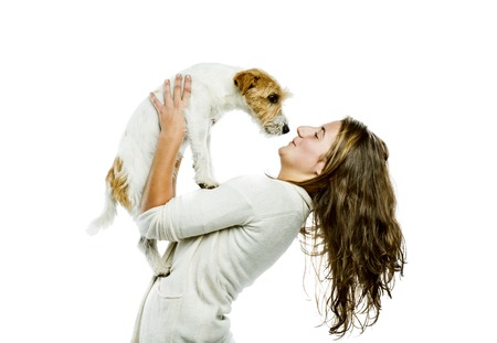 Young woman holding her cute parson russell terrier dog isolated on white background Stock Photo