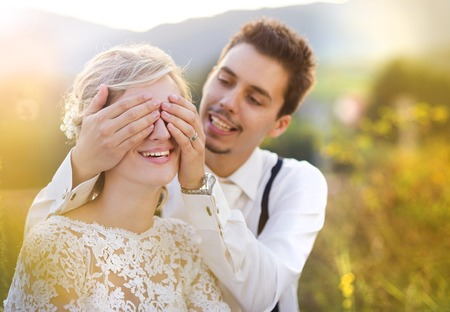 bridal couple: Young wedding couple enjoying romantic moments sitting on a meadow, summer nature outdoor