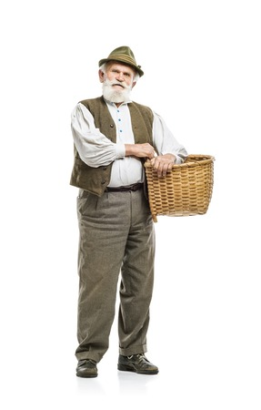 agriculturist: Old bearded farmer man in hat holding basket, isolated on white background Stock Photo