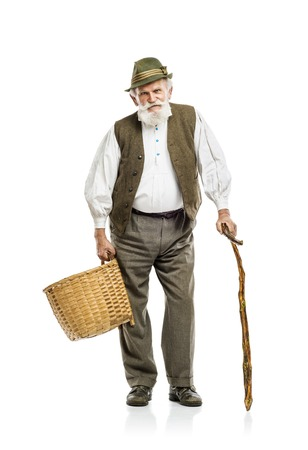 Old bearded farmer man in hat holding basket, isolated on white background photo