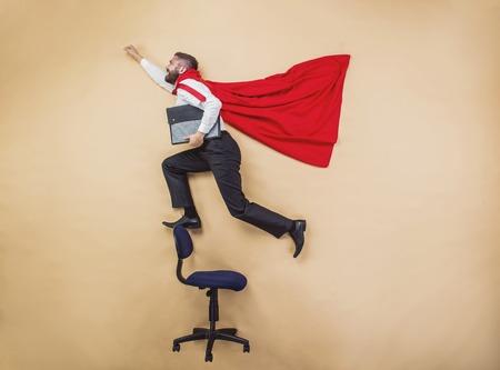 solver: Manager with coat. Superhero in studio.