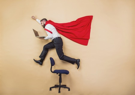 fast: Manager with coat of superman. Superhero in studio.