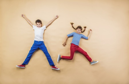 funny people: Funny children are playing together. Lying on the floor. Stock Photo
