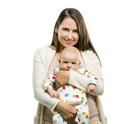 mom holding baby: Smiling mother holding a baby in her arms isolated on white background Stock Photo