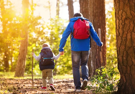 hiking: Father and son in forest