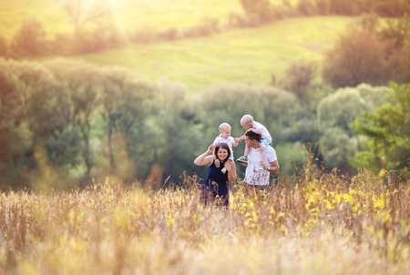 family on grass: Family in nature