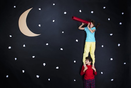 Children getting ready for bedtime. Studio shot on a black background. photo
