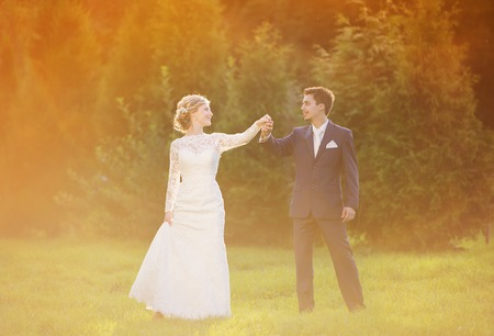 Young wedding couple enjoying romantic moments outside in summer park Stok Fotoğraf