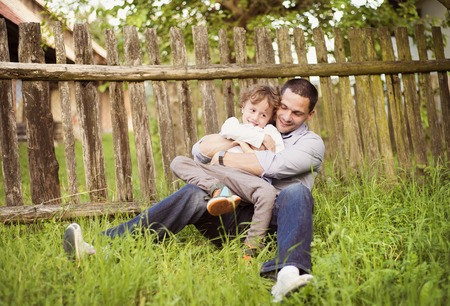 Little boy and his dad enjoying their time together outside in nature