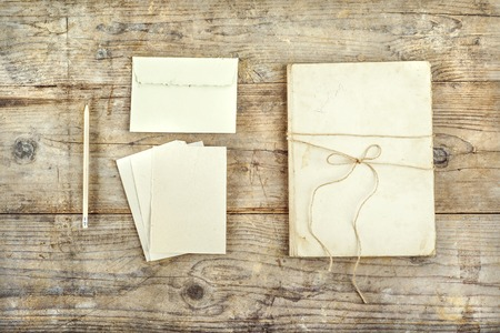 old envelope: Stationery set on a wooden floor background. View from above.