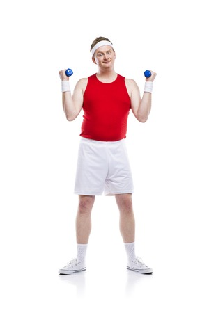weak: Funny weak body builder tries to lift a weight. Studio shot on white background.