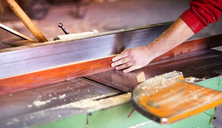 wood planer: Hands of carpenter working with electric wood planer in his workshop Stock Photo