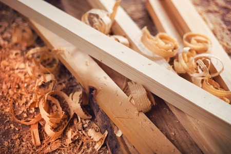 Wooden planks and shavings at carpenters workshop Reklamní fotografie - 36097196