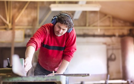 wood planer: Carpenter working with electric wood planer in his workshop