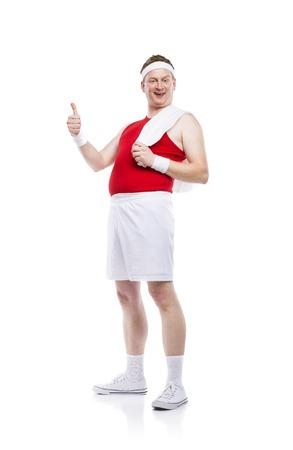 Funny weak body builder tries to exercise. Studio shot on white background.