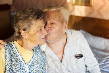 lifelong: Happy senior couple in love inside of their house