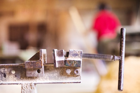 clamps: Carpenter screw clamp tools pressing planks together