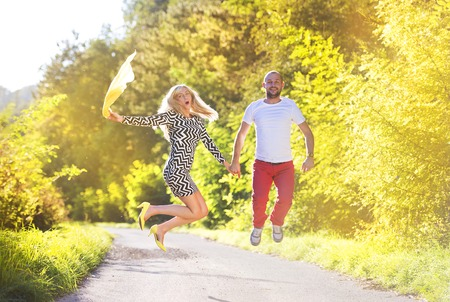 young people fun: Attractive happy young couple having fun outside in a park Stock Photo