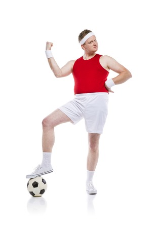 clumsy: Funny clumsy football player with a ball. Studio shot on white background.