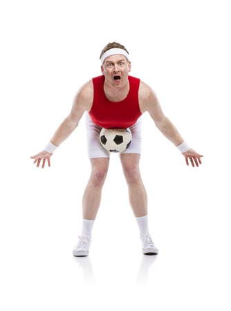 Funny clumsy football player with a ball. Studio shot on white background. photo