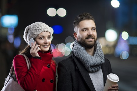 dark night: Trendy young hipster couple enjoying nightlife in the city Stock Photo