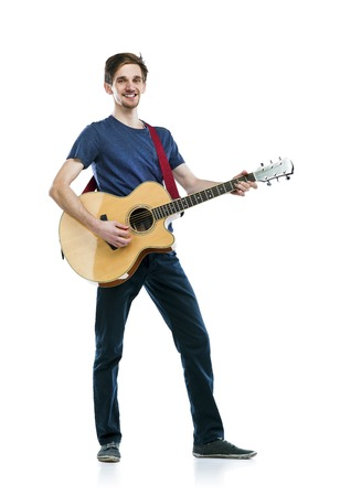 Young handsome guitar player with his instrument. Studio shot on white background.