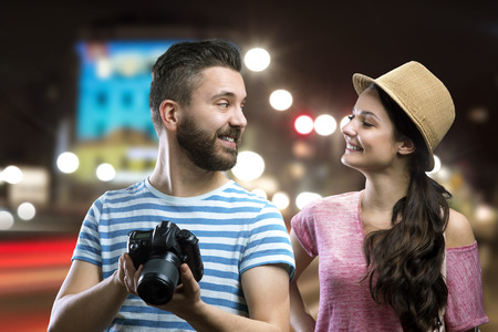 Trendy young hipster couple enjoying nightlife in the city photo