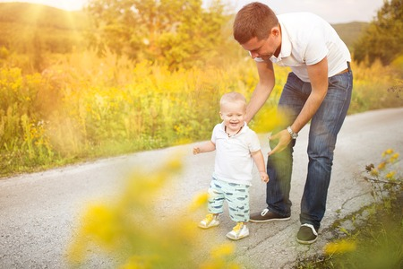 Father and son on a walk in nature enjoying life together.