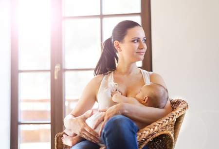 breast girl: Mother breastfeeding her little baby girl in her arms.