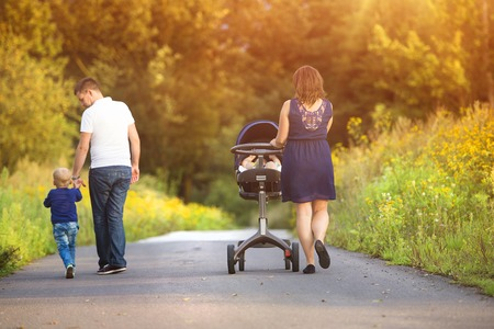 Happy family on a walk in nature enjoying life together.