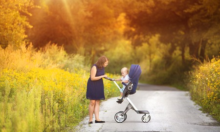 sunglight: Mother and son on a walk in nature enjoying life together.