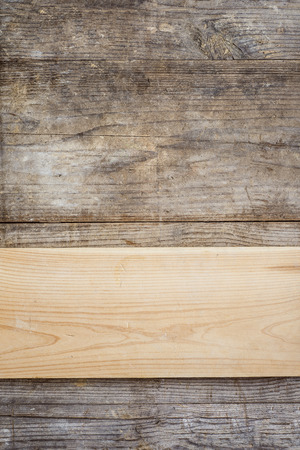 Board with texture laid on wooden floor background photo