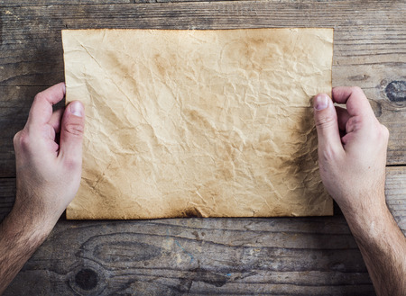rumpled: Piece of old rumpled paper on wooden floor background Stock Photo