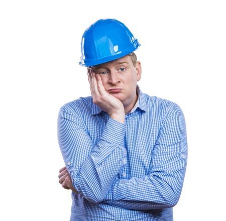 facial gestures: Engineer in blue hard hat. Studio shot on white background.