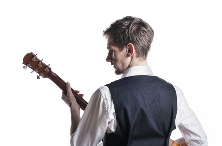 back shots: Young handsome guitar player. Studio shot on white background.