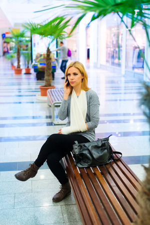 broken arm: Beautiful woman with broken arm inside of a shopping center