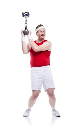 Funny weak sportsman with a trophy. Studio shot on white background. photo