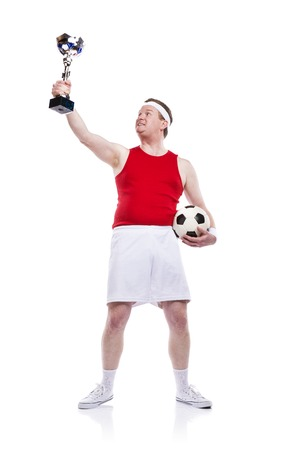 clumsy: Jugador de f�tbol divertido torpe con una pelota. Estudio tirado en el fondo blanco. Foto de archivo