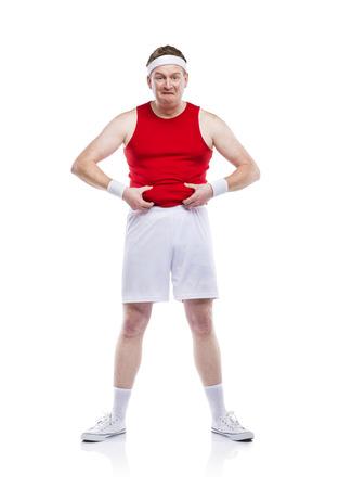 Funny weak sportsman exercising. Studio shot on white background. photo