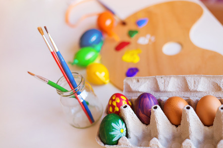 Table prepared for hand painting of easter eggs photo