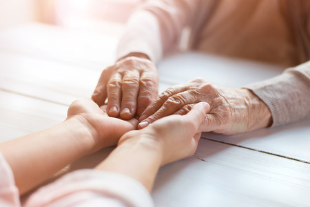 Unrecognizable grandmother and her granddaughter holding hands. Stock Photo - 37859686