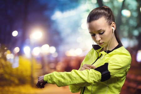 woman jogging: Young woman jogging at night in the city Stock Photo